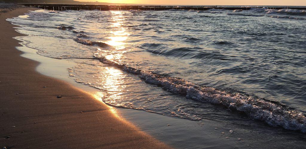 Begenung am Meer: Sonnenuntergang